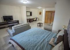 Atlantis Beach Hotel - Monrovia - Habitación