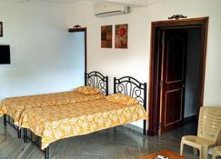 Siolim Holiday Apartments - Vagator - Makuuhuone