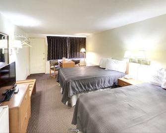 Travelers Inn - Belleville - Schlafzimmer