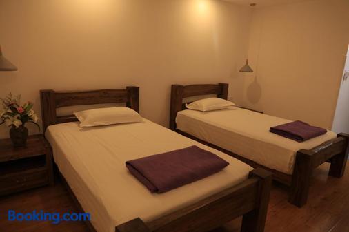 Beijing Downtown Travelotel - Beijing - Bedroom