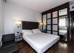 AC Hotel Padova by Marriott - Padua - Schlafzimmer