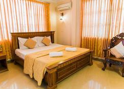 Star Hotel - Battambang - Soveværelse