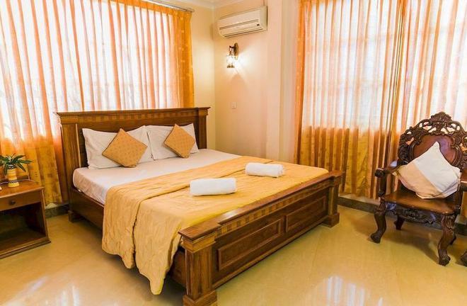 Star Hotel - Battambang - Phòng ngủ