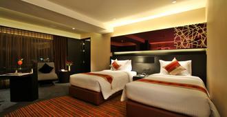 Golden Tulip Mandison Suites - Bangkok - Schlafzimmer