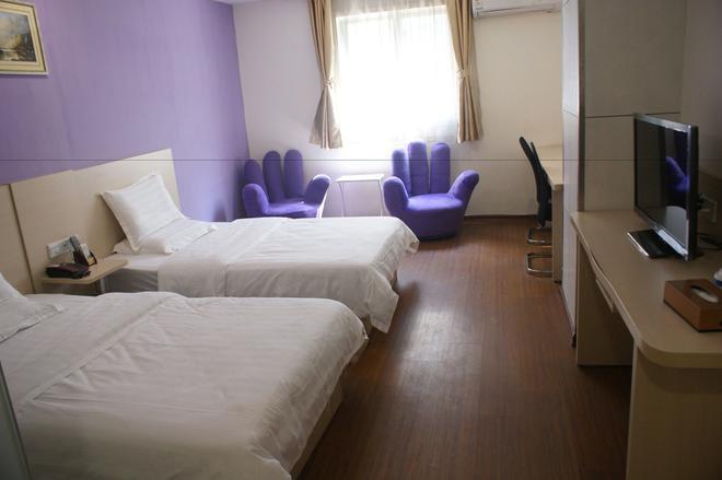 Yixin Business Hotel - Guangzhou - Bedroom