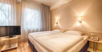 Enjoy Hotel Berlin City Messe - Berlin - Bedroom