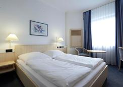 Intercityhotel Kiel - Kiel - Phòng ngủ