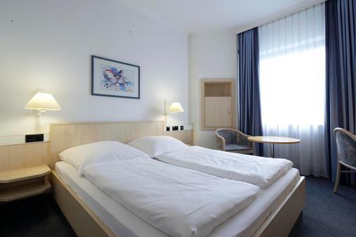 Intercityhotel Kiel - Киль - Спальня