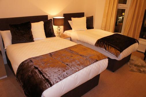 Sapphire Hotel - London - Phòng ngủ