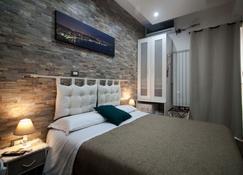 Guesthouse Il Fauno - Suite & Spa - ปอมเปอี - ห้องนอน