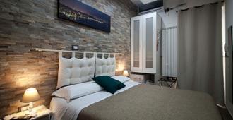 Guesthouse Il Fauno - Suite & Spa - פומפיי - חדר שינה