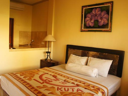 La'Mulya Guest House - Kuta - Phòng ngủ
