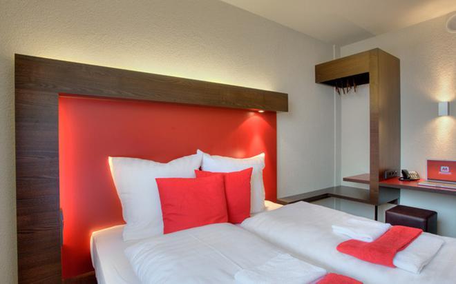 โรงแรมไมนิงเงอร์ เบอร์ลิน เฮาพท์บานโฮฟ - เบอร์ลิน - ห้องนอน