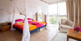 Q-Bar & Guest House - Dar es Salaam - Habitación