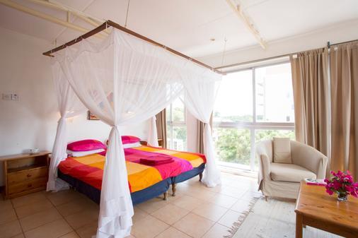 Q-Bar & Guest House - Dar Es Salaam - Phòng ngủ