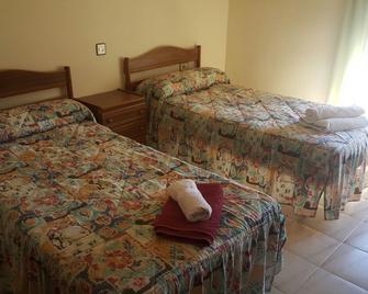 hostal restaurante avenida - Alhama de Aragón - Camera da letto