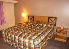 Economy Inn - Vịnh Xanh (Green Bay) - Phòng ngủ