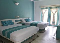 Hotel Plaza Delphinus - La Crucecita - 臥室