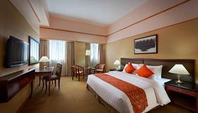 成功馬卡迪酒店 - 馬卡蒂 - 臥室