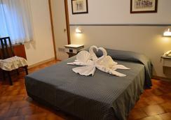 波爾塔艾圖菲酒店 - 錫耶納 - 錫耶納 - 臥室