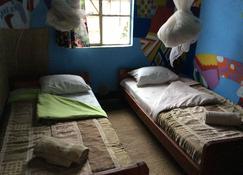 Redrocks Hostel Rwanda - Ruhengeri - Yatak Odası