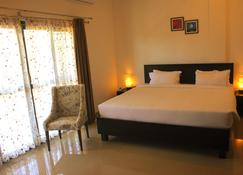 The Yellow Bamboo Resort & Spa - Gonikoppal - Habitación