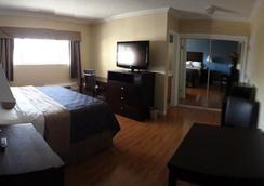 Metropolitan Inn & Suites - Los Angeles - Phòng ngủ