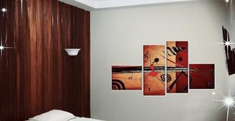 Piccolo Hostal - Managua - Schlafzimmer