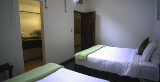 Hotel El Carmen - Antigua Guatemala - Schlafzimmer