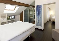Hotel America - Locarno - Κρεβατοκάμαρα