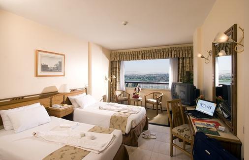 Swiss Inn Nile Hotel - Cairo - Phòng ngủ