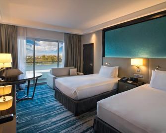 Radisson Blu Hotel and Resort Al Ain - Ал Аін - Спальня