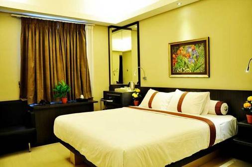 陽光精品酒店 - 庫塔 - 庫塔 - 臥室