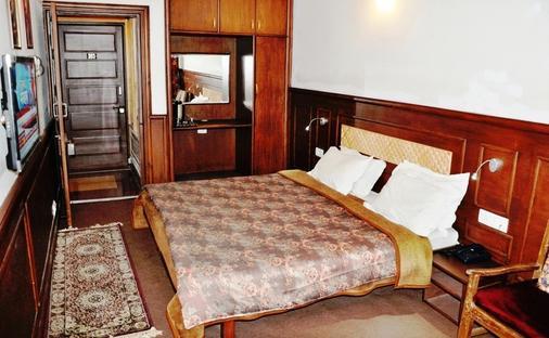 Hotel Sadaf - Srinagar - Phòng ngủ