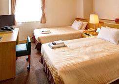 Okinawa Sunplaza Hotel - Naha - Makuuhuone