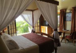 Charela Inn - Negril - Κρεβατοκάμαρα