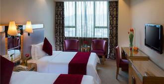 Vienna3 Best Hotel Shenzhen Pinghu Square - שנג'ן - חדר שינה