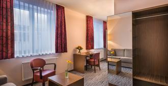 Novum Hotel Dresden Airport - Dresden - Living room