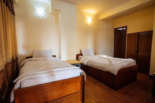 Hotel Pomelo House - Kathmandu - Bedroom