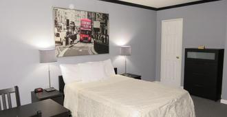 Central Motel Courtyard - White Plains - Bedroom