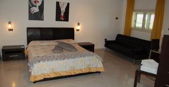 米爾托拉玫瑰酒店 - 敘拉古 - 錫拉庫扎 - 臥室
