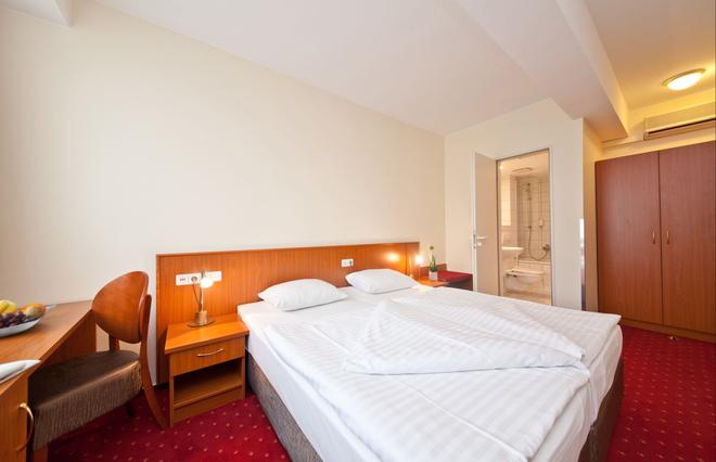 Novum Hotel Belmondo Hamburg Hbf. - Amburgo - Camera da letto