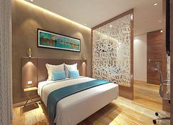 愛菲托薩亞吉飯店 - 巴羅達 - 臥室