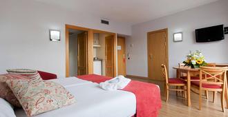 Aparto Suites Muralto - מדריד - חדר שינה