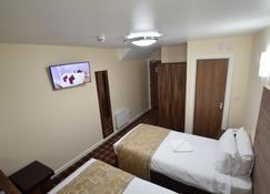 Lucky 8 Hotel - Ilford - Camera da letto