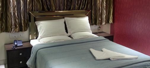 Hotel Kamran Residency - Мумбаи - Спальня
