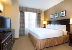 Holiday Inn Express & Suites S Lake Buena Vista - Kissimmee - Schlafzimmer