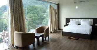 Treebo Trend Anandam Resort - Rishikesh - Bedroom