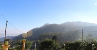 J R Mist Valley Inn - Ooty - Outdoor view