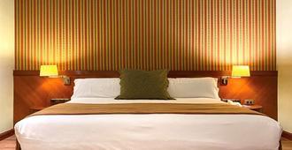 هوتل توري مانجانا - كوينكا - غرفة نوم